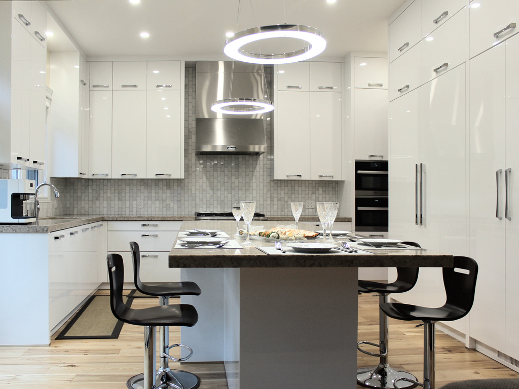 Kitchen interior with white cabinets, quartz countertop, and Miele appliances, Toronto