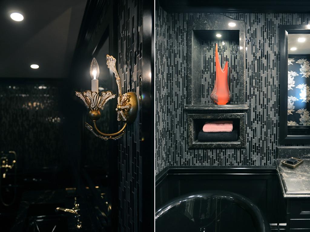 Bathroom with black cabinets, a black bathtub, a black sink, a black lavatory pan, black toilet paper, black soap and golden faucets.