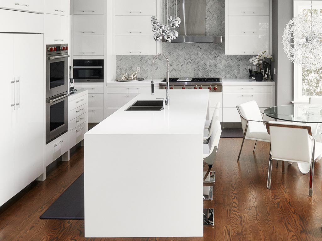 Kitchen interior with white cabinets and Miele appliances, Toronto