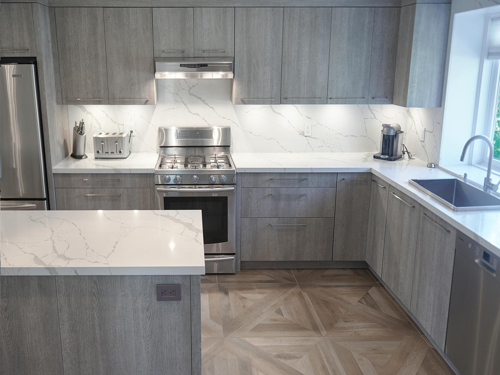 Toronto kitchen with cabinetry in weathered wood style and Samsung appliances