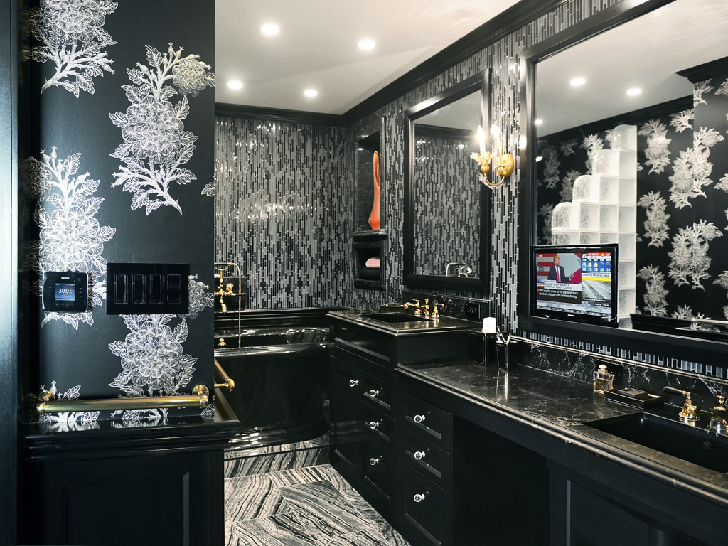 Bathroom with black cabinets, a black bathtub, a black sink, a black lavatory pan, black toilet paper, black soap and golden faucets.