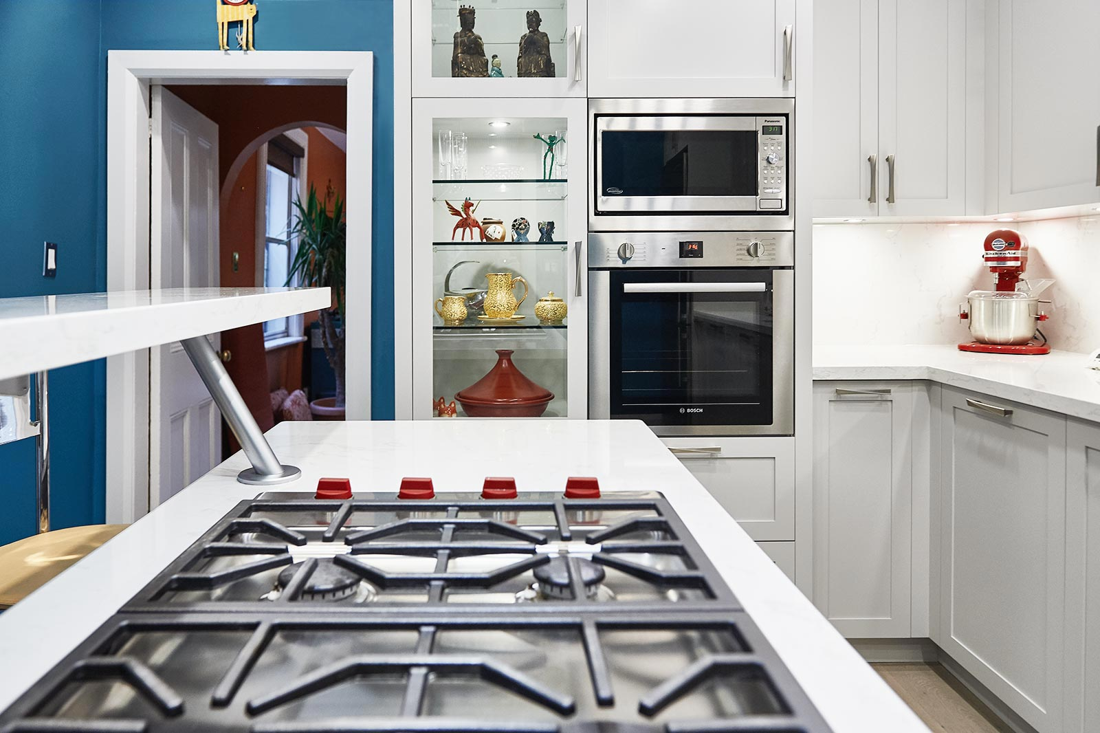 Shaker style cabinetry with blue walls in Victorian house. Toronto, Canada