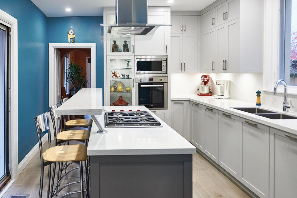 Shaker style white cabinets with blue walls in Victorian house. Toronto, Canada